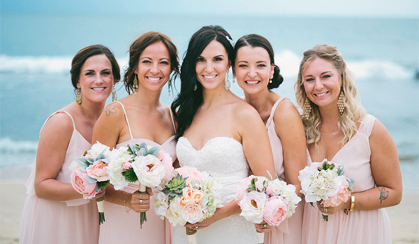 Bride and bridesmaids holding tropical bouquets