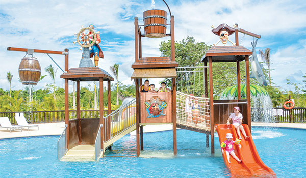 Pirate-themed splash park with water slides and water features
