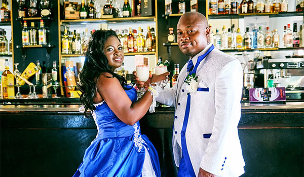 Bride and groom sitting at the bar