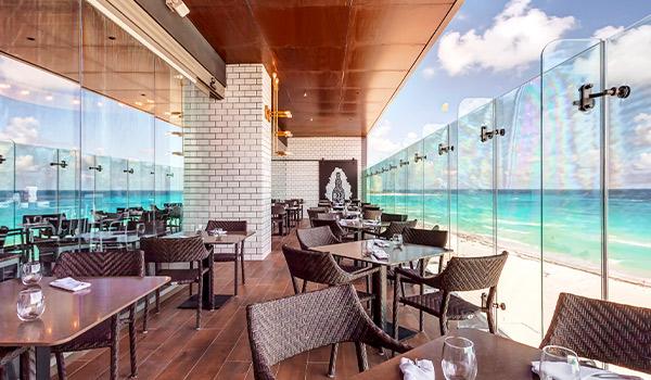 Restaurant patio on a balcony overlooking the ocean