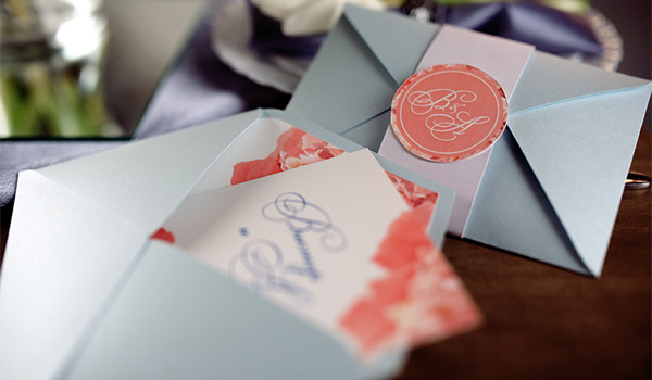 Wedding invitation with coral-coloured embossing