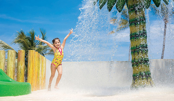 Little girl playing in the splash pad at Barceló Huatulco