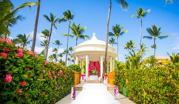 Wedding gazebo surrounded by lush gardens