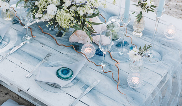 Table scape with flowers and geodes