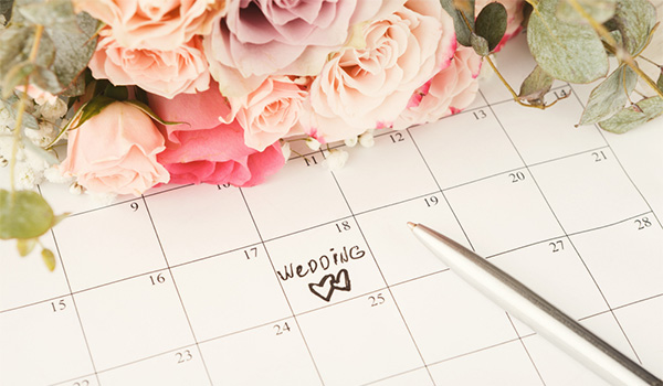 "Calendar with a date circled saying ""wedding"""