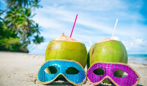 Pair of masks in front of coconuts