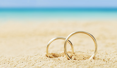 Two wedding rings on the beach