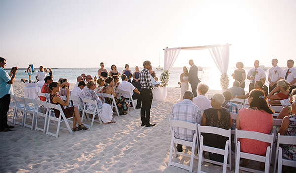 Wedding ceremony on the beach at sunset