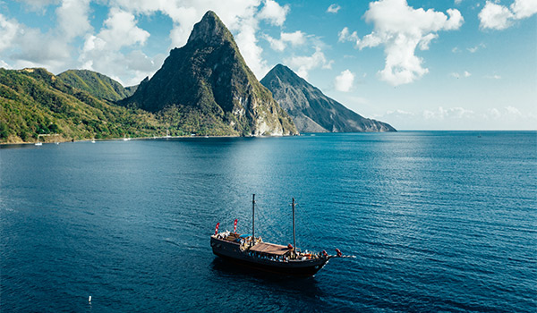 Sailboat cruising along the coast