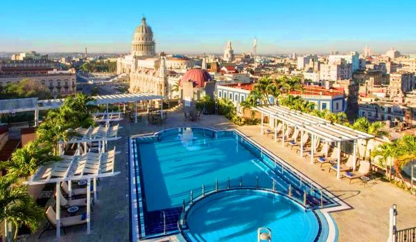 Rooftop bar and pool overlooking the historical buildings of Havana