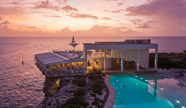 Resort overlooking the ocean at sunset
