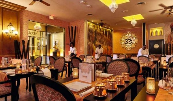 Indian-themed restaurant with candle votives and gold décor