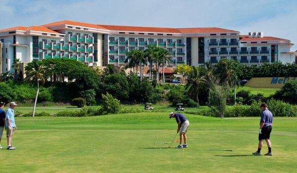People golfing on the pristine greens of Varadero Golf Club