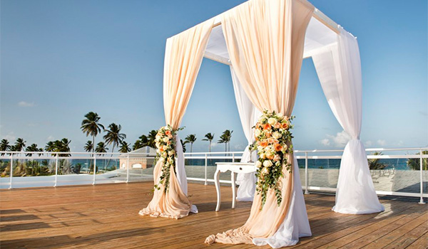 Wedding ceremony on a rooftop patio overlooking the beach