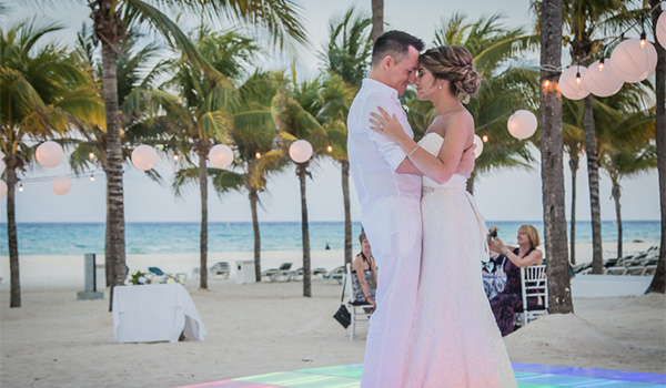 Bride and groom dancing on the beach