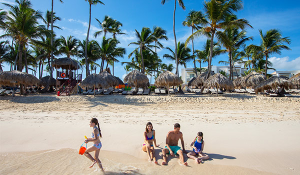 Family playing in the sand on Bavaro Beach