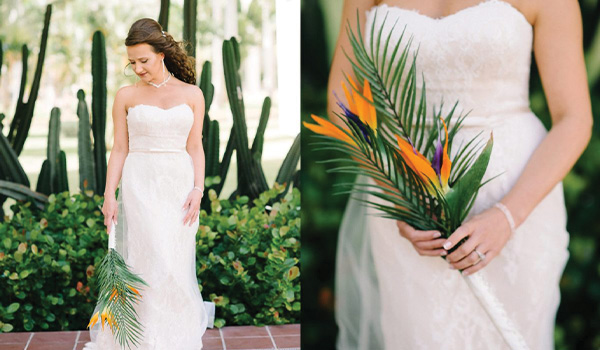 Bride holding a bouquet with areca palm