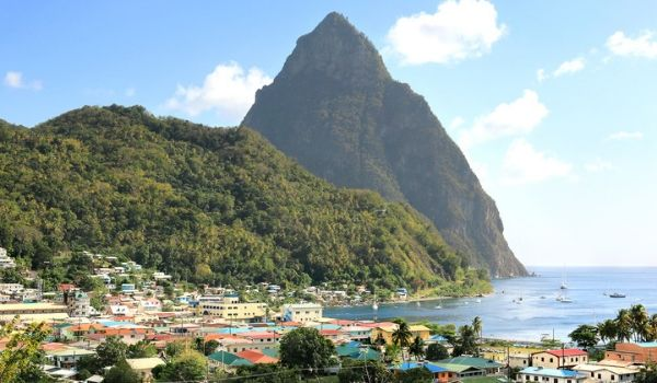 Houses overlooking the ocean with Pitons in the background