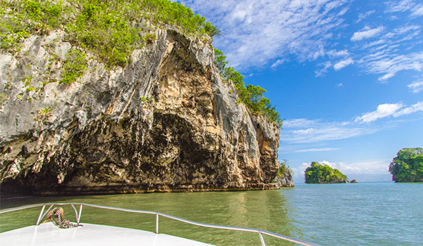 Boat overlooking remarkable rock formations