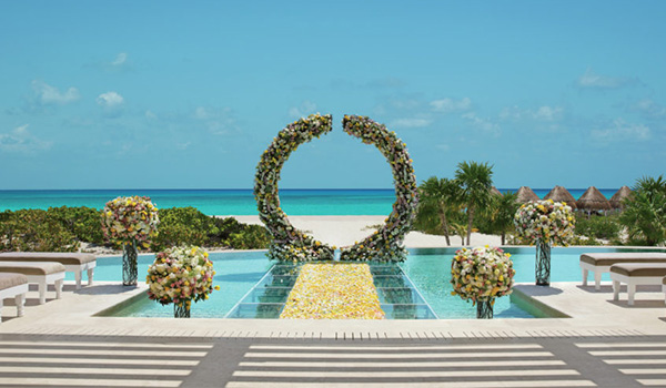 Elegant circular floral altar situated on a sparkling pool