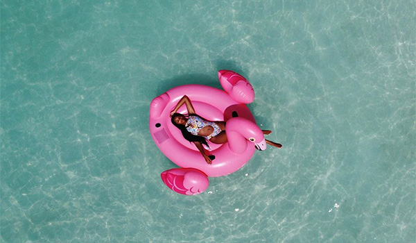 Aerial view of woman floating in the pool