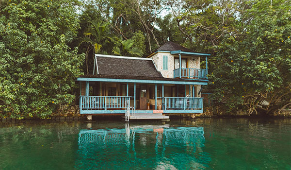 House overloooking a river surrounded by lush tropical forest