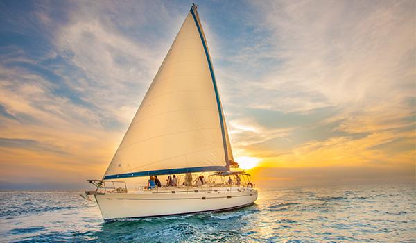 A luxurious sailboat at sunset