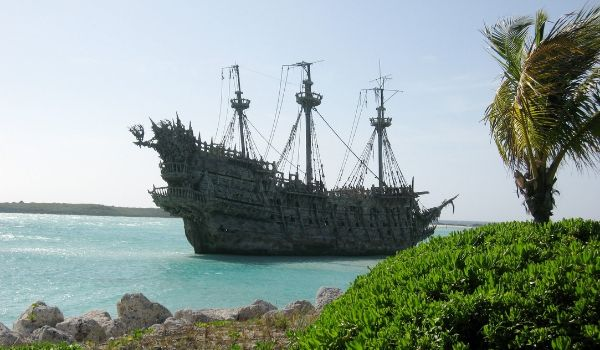 Replica old pirate ship anchored off the Bahamian coast