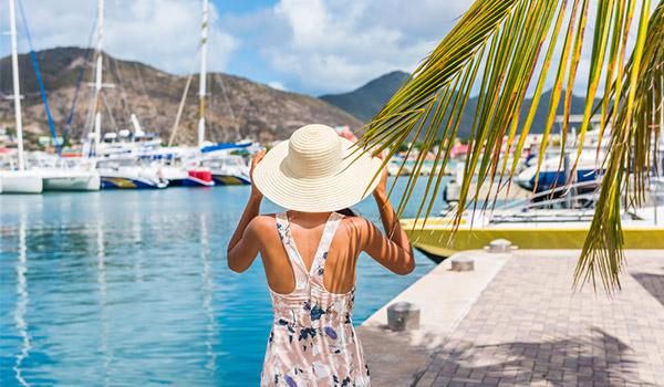 Woman walking along the marina in St Maarten