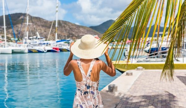 Woman walking along the marina in St Maarten