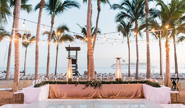 Wedding reception on the beach at sunset