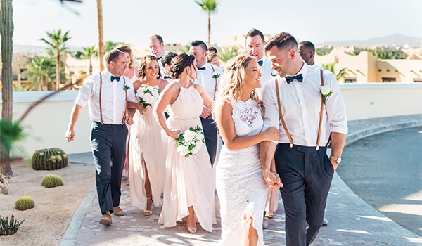Bride and groom walking with their bridesmaids and groomsmen