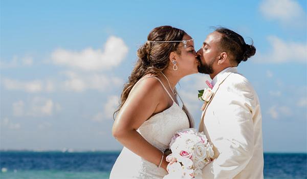 Sheniqua and Ejaz share a kiss on the beach..