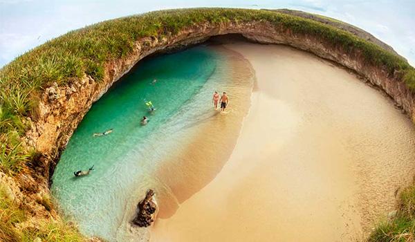 Aerial view of Hidden Beach's golden-sand shores