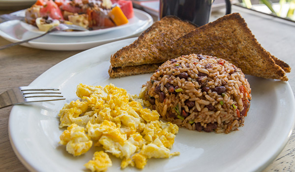 Gallo Pinto on a plate with toast and scrambled eggs
