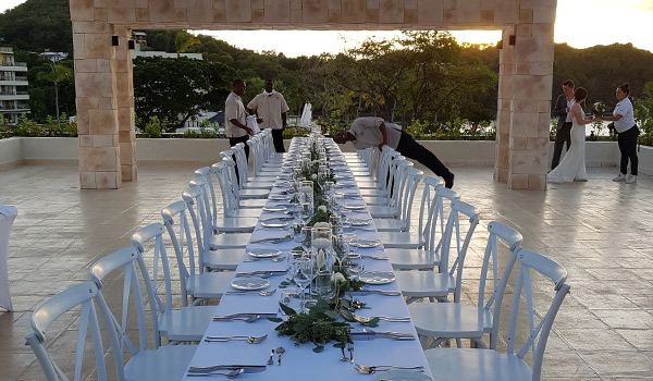 Wedding reception on a rooftop terrace at sunset