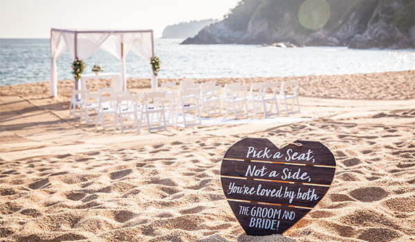 Elegant beachfront wedding venue with heart sign in the foreground