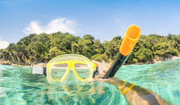 Snorkel mask in crystal-clear water
