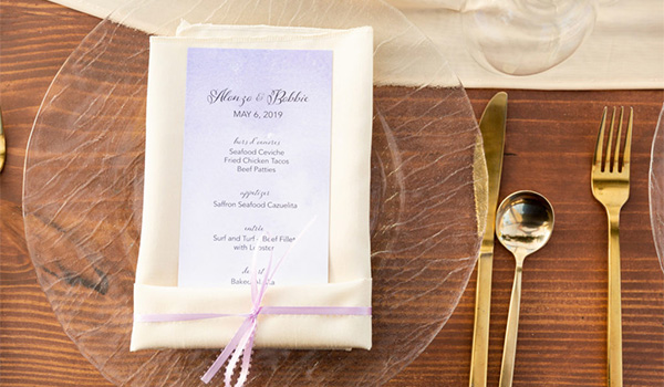 Menu, plate and cutlery on a table