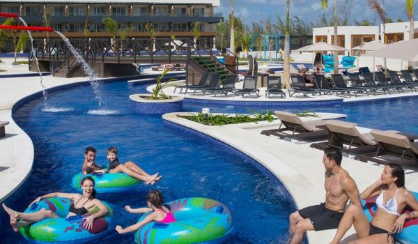 Vacationers floating down the winding lazy river