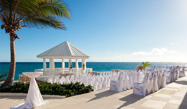 Wedding ceremony by a gazebo overlooking the ocean