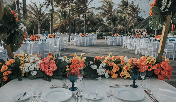 Elegant dinner table with tropical flowers
