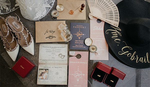 Wedding accessories and invitations on a table