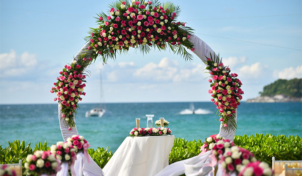 Floral arch overlooking the ocean