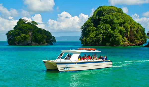 Vacationers on a catamaran cruise through Los Haitises National Park