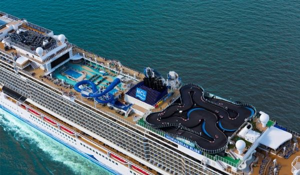Aerial view of a cruise ship with a racetrack and water park