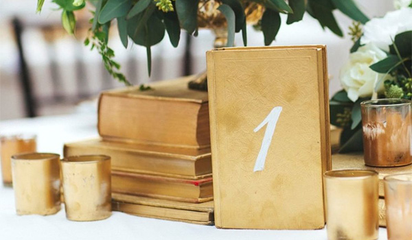 Notebook painted gold with numbers on the cover