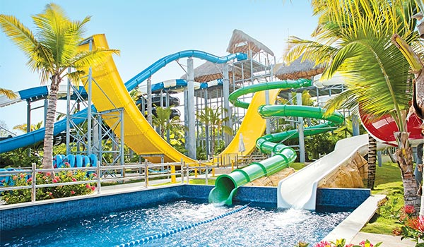 View from below of twisting slides at a water park