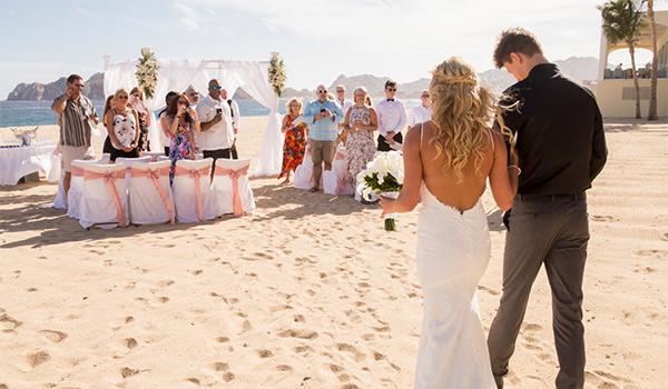 Bride walking down the aisle on the beach