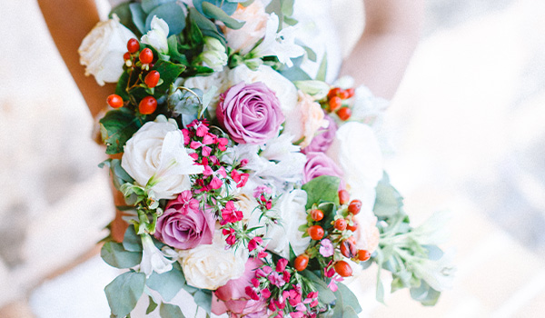 Colourful bouquet with yarrow, roses and eucalyptus